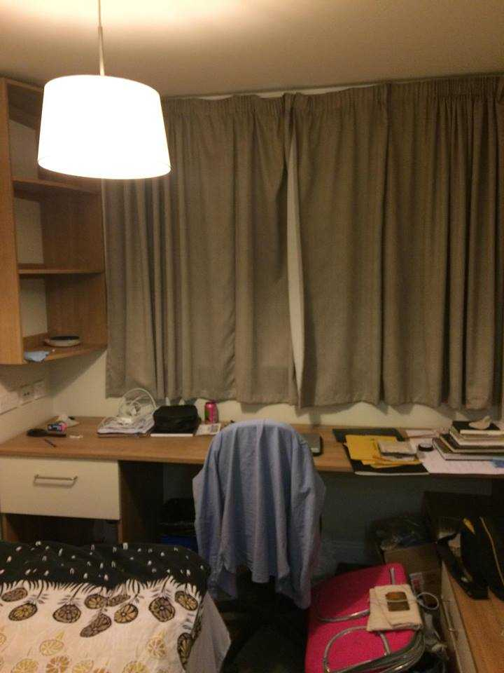 Photo of a room in 1-room student hall in London.